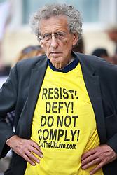 © Licensed to London News Pictures. 25/09/2021. Brighton, UK. Coronavirus conspiracy believers, led by Piers Corbyn, protest outside the conference venue. The first day of the 2021 Labour Party Conference , which is taking place at the Brighton Centre . Photo credit: Joel Goodman/LNP