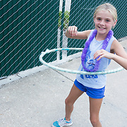Addy Miller, 8, hula hoops Thursday August 7, 2014 during The Shrip-A-Roo at Buddy's Crab House & Oyster Bar in Wrightsville Beach, N.C.  (Jason A. Frizzelle)