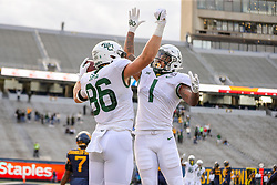 Oct 3, 2020; Morgantown, West Virginia, USA; Baylor Bears tight end Ben Sims (86) scores a touchdown and celebrates with running back Trestan Ebner (1) during the first overtime against the West Virginia Mountaineers at Mountaineer Field at Milan Puskar Stadium. Mandatory Credit: Ben Queen-USA TODAY Sports