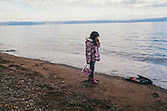 A Syrian girl on a beach near Molyvos, Lesvos island in Greece. She just arrived from Turkey on a rubber dinghy wearing her favourite clothes, all in matching pink.
