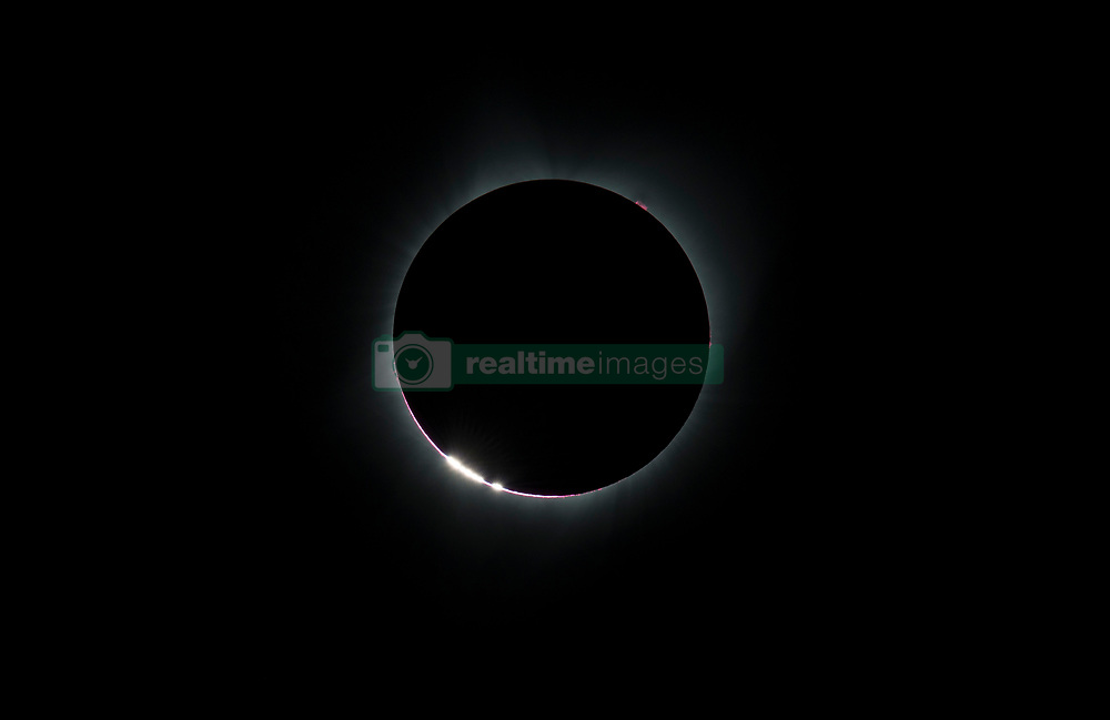 The Bailey's Beads  effect is seen as the moon makes its final move over the sun during the total solar eclipse on Monday, August 21, 2017 above Madras, Oregon. A total solar eclipse swept across a narrow portion of the contiguous United States from Lincoln Beach, Oregon to Charleston, South Carolina. A partial solar eclipse was visible across the entire North American continent along with parts of South America, Africa, and Europe.  Photo Credit: (NASA/Aubrey Gemignani)  Please note: Fees charged by the agency are for the agency's services only, and do not, nor are they intended to, convey to the user any ownership of Copyright or License in the material. The agency does not claim any ownership including but not limited to Copyright or License in the attached material. By publishing this material you expressly agree to indemnify and to hold the agency and its directors, shareholders and employees harmless from any loss, claims, damages, demands, expenses (including legal fees), or any causes of action or allegation against the agency arising out of or connected in any way with publication of the material.