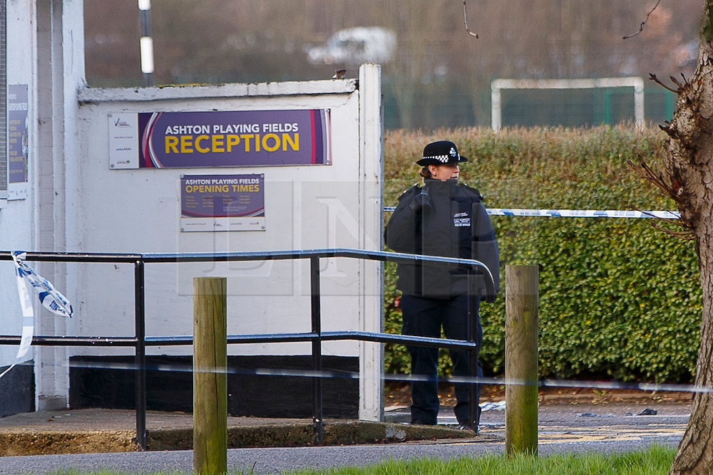 © Licensed to London News Pictures. 10/01/2016. London, UK. Police officers investigating a crime scene at Ashton Playing Fields in Woodford, east London, where a 16-year-old boy was stabbed to death on Sunday, 10 January 2016. Photo credit: Tolga Akmen/LNP