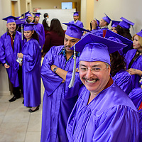 Delfina Sanchez and his wife Sofia Sanchez, right, smile as they line up with their classmates for the New Life Learning Center graduation ceremony Friday at Lighthouse Church in Gallup.