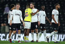 Derby County's Richard Keogh (centre) greets Blackburn Rovers' Kasey Palmer after the final whistle