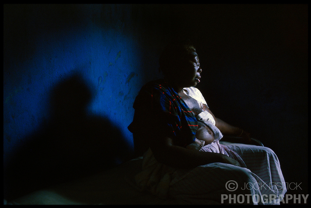 CAP HAITIEN, HAITI - Eileen Dodien recovers from third degree burns she suffered when a lantern exploded as she was trying to light it. The fire destroyed her home and her life savings of $1500, which she had hidden in her mattress.