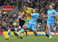 Photo: Ashley Pickering.<br />Norwich City v Coventry City. Coca Cola Championship. 24/02/2007.<br />Isaac Osbourne of Coventry (R) tackles Darren Huckerby of Norwich