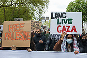 Protesters walk behind a banner holding pro-Palestinian signs during a Free Palestine SOS Colombia march in solidarity with the Palestinian and Colombian peoples from the Colombian embassy to the Israeli embassy on 15th May 2021 in London, United Kingdom. Speakers at a rally before the march, which took place on Nakba Day, highlighted human rights abuses being directed against Palestinians in Israel and the Occupied Territories, in particular attempts at forced displacements in Sheikh Jarrah in East Jerusalem, and also in Colombia, where peaceful demonstrators and human rights defenders have been killed and subjected to repression, detention and torture.