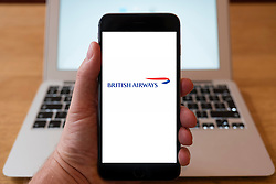 Using iPhone smartphone to display logo of British Airways airline