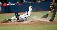 Aug 27, 2014; Toronto, Ontario, CAN; Toronto Blue Jays centre field Kevin Pillar makes home plate from hit by short stop Jose Reyes (7) (not in picture) Boston Red Sox in the seventh inning at Rogers Centre. Mandatory Credit: Peter Llewellyn-USA TODAY Sports
