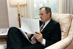 United States President George H.W. Bush reviews his first State of the Union Address in his study in the Oval Office of the White House in Washington, DC, USA, on February 8, 1989. Photo by David Valdez / White House via CNP/ABACAPRESS.COM