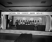 "B.I.M.National Seafood Cook..1972..05.05.1972..05.05.1972..5th May 1972..The final of the ""National Seafood Cook 1972"" was held in the Great Southern Hotel,Killarney,Co Kerry.The winner was Miss Mary Coleman (14 years)from the Vocational School, Claremorris,Co Mayo.The title of the winning dish was ""Amber Ring. She was chosen from 18 regional finalists...Picture of all the regional finalists on the platform with members of the organising committee and judging panel."