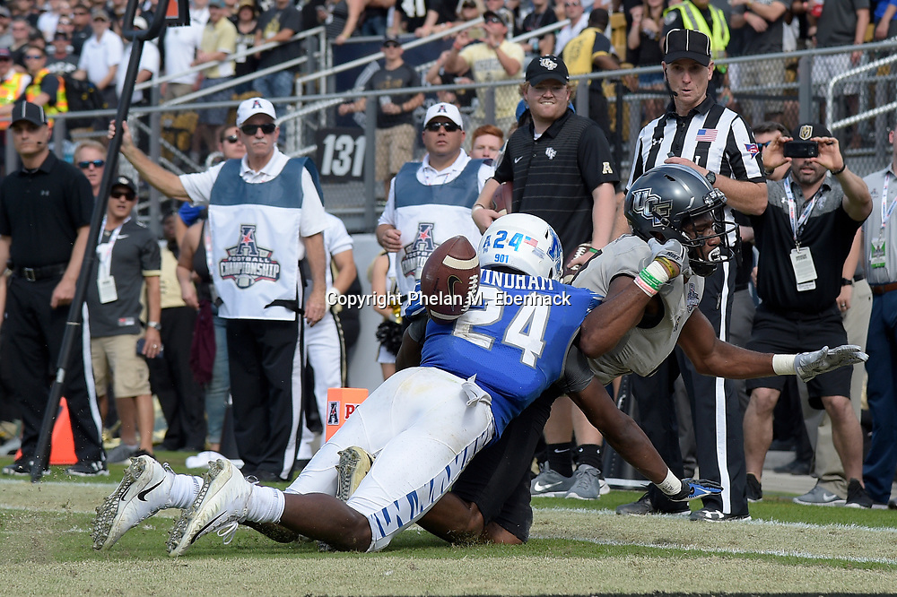 Memphis defensive back Tito Windham (24) breaks up a pass intended for Central Florida wide receiver Tre'Quan Smith (4) in the end zone during the first half of the American Athletic Conference championship NCAA college football game Saturday, Dec. 2, 2017, in Orlando, Fla. (Photo by Phelan M. Ebenhack)