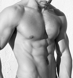detail of a muscular man's chest and abs