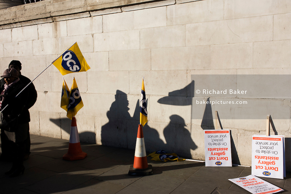 Staff silhouetted from the Public and Commercial Services Union PCS union outside National Gallery, London