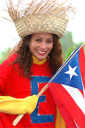 Performer age 29 with Puerto Rican flag at Cinco de Mayo.  St Paul Minnesota USA