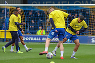 AFC Wimbledon striker Joe Pigott (39) and AFC Wimbledon striker Kweshi Appiah (9) warming up during the EFL Sky Bet League 1 match between AFC Wimbledon and Accrington Stanley at the Cherry Red Records Stadium, Kingston, England on 6 April 2019.