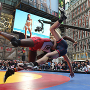 Nate Rose, (left), New York City, and Tony Cassas, New Jersey, in action during a warm up fight before the main event the 'Beat The Streets' USA Vs The World, International Exhibition Wrestling in Times Square. New York, USA. 7th May 2014. Photo Tim Clayton