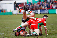 Keighley Cougars scrum half Matty Beharrell (7) with a spear tackle on Bradford Bulls second row Elliot Minchella (12)  during the Betfred League 1 match between Keighley Cougars and Bradford Bulls at Cougar Park, Keighley, United Kingdom on 11 March 2018. Picture by Simon Davies.