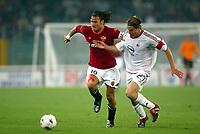 Roma 20 Maggio 2003 - Rome May 20 2003 <br />Andata finale di Coppa Italia - First Match final Italy's Cup <br />Roma Milan 1-4 <br /><br />Francesco Totti (roma) e Massimo Ambrosini<br /><br />Francesco Totti (roma) challenged by  Massimo Ambrosini and Cristian Brocchi (Milan)