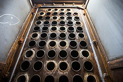 """© Licensed to London News Pictures. 04/05/2016. Birkenhead UK. Picture shows the inside of the Steam engine on the Daniel Adamson during restoration at Camel Laird docks. The Daniel Adamson steam boat has been bought back to operational service after a £5M restoration. The coal fired steam tug is the last surviving steam powered tug built on the Mersey and is believed to be the oldest operational Mersey built ship in the world. The """"Danny"""" (originally named the Ralph Brocklebank) was built at Camel Laird ship yard in Birkenhead & launched in 1903. She worked the canal's & carried passengers across the Mersey & during WW1 had a stint working for the Royal Navy in Liverpool. The """"Danny"""" was refitted in the 30's in an art deco style. Withdrawn from service in 1984 by 2014 she was due for scrapping until Mersey tug skipper Dan Cross bought her for £1 and the campaign to save her was underway. Photo credit: Andrew McCaren/LNP ** More information available here http://tinyurl.com/jsucxaq **"""