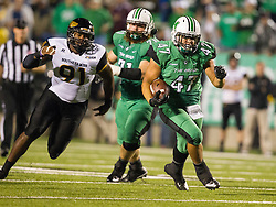 Oct 9, 2015; Huntington, WV, USA; Marshall Thundering Herd running back Devon Johnson runs the ball up the middle during the second quarter against the Southern Miss Golden Eagles at Joan C. Edwards Stadium. Mandatory Credit: Ben Queen-USA TODAY Sports