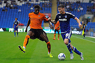 Cardiff City's Joe Mason (r) takes on Wolves' Ethan Ebanks-Landell. Skybet football league championship match, Cardiff city v Wolverhampton Wanderers at the Cardiff city stadium in Cardiff, South Wales on Saturday 22nd August 2015.<br /> pic by Carl Robertson, Andrew Orchard sports photography.
