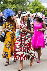 Ascot, UK. 20 June, 2019. Racegoers wearing fancy hats attend Ladies Day at Royal Ascot.