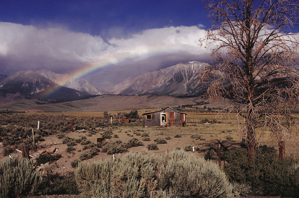 Rainbow over abandoned cabin in Owen's Valley, California. Near Lee Vining on Route 395: Eastern Sierra Nevada Mountains of California.
