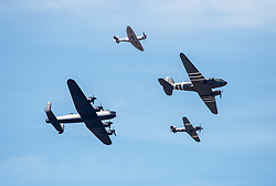 © Licensed to London News Pictures.  24/06/2018; Weston-super-Mare, North Somerset, UK. The BATTLE OF BRITAIN MEMORIAL FLIGHT at Weston Air Festival, during the RAF centenary year. Air displays take place over the Seafront and Beach Lawns at Weston-super-Mare, including the Battle of Britain Memorial Flight and the Red Arrows display team. Photo credit: Simon Chapman/LNP