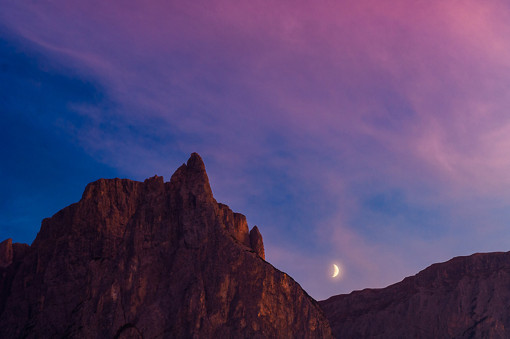 The Schlern, 2,563 meters elevation, and crescent moon, evening light, Schlern-Rosengarten Nature Reserve, South Tyrol, Italy