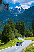 Mercedes E Class saloon car touring in the Swiss Alps, Swiss National Park, Switzerland