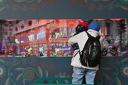 November 19, 2018 - Paris, france - PARIS, Nov. 19, 2018 () -- A tourist and her child in front of the Christmas shop window of Galeries Lafayette in Paris, France, Nov. 19, 2018. (Credit Image: © Panoramic via ZUMA Press)