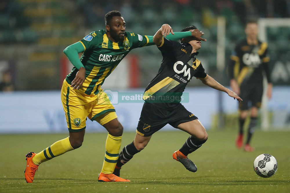 (L-R) Wilfried Kanon of ADO Den Haag, Manu Garcia of NAC Breda during the Dutch Eredivisie match between ADO Den Haag and NAC Breda at Cars Jeans stadium on March 10, 2018 in The Hague, The Netherlands