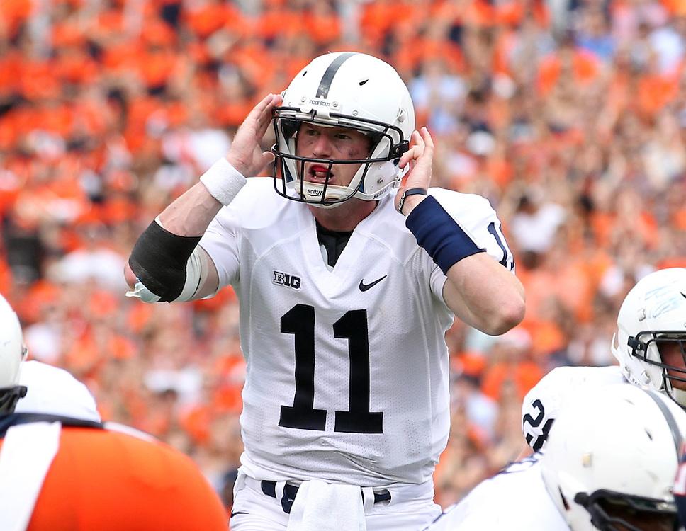 Penn State quarterback Matthew McGloin (11) calls a play during an NCAA college football game against Virginia in Charlottesville, Va. Virginia defeated Penn State 17-16.