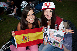 © Licensed to London News Pictures . 19/08/2013 . London, UK. One Direction fans camp in Leicester Square, London, ahead of the World Film premier 'One Direction: This is Us 3D' at the Empire Cinema tomorrow (20/08/2013) . Photo credit : /LNP. Photo credit : Isabel Infantes/LNP