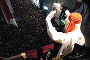 The Miller is waving hands to the people of Ivrea from the City Hall, where thousands of people have made their way for the opening of the Carnival of Ivrea, pop. 30.000. During the days of the Carnival, the town becomes crammed with tourists coming to witness the event which finds its roots at the end of the XII Century, when the people led an insurrection against the local tyrant, Count Ranieri of Biandrate, who was exercising the 'jus primae noctis' rule (having the first night) on the local young brides. The battle to overthrow him is represented with a 3-day-fight between factions in which more then 400 tonnes of oranges are thrown. During the celebrations, food stalls, bands playing music, and parades are also present, giving it a typical Medieval atmosphere. ..