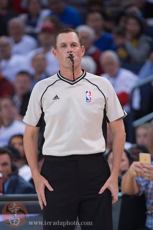 December 25, 2015; Oakland, CA, USA; NBA referee Matt Boland (18) during the second quarter in a NBA basketball game on Christmas between the Golden State Warriors and the Cleveland Cavaliers at Oracle Arena. The Warriors defeated the Cavaliers 89-83.