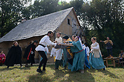 Historical and fictional theatre play acted out at the Medieval village of the town, and with actors wearing traditional costumes for European heritage days on 18th September 2021 in Pont Croix, Brittany, France. Brittany is a peninsula, historical county, and cultural area in the west of France, covering the western part of what was known as Armorica during the period of Roman occupation. It became an independent kingdom and then a duchy before being united with the Kingdom of France in 1532 as a province governed as a separate nation under the crown.