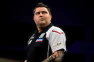A dejected Michael Smith as he realises he is out of the Premier League during the Premier League Darts  at the Motorpoint Arena, Cardiff, Wales on 31 March 2016. Photo by Shane Healey.