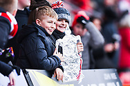 Two young Doncaster fans pose with their home made FA Cup trophy during the The FA Cup fourth round match between Doncaster Rovers and Oldham Athletic at the Keepmoat Stadium, Doncaster, England on 26 January 2019.