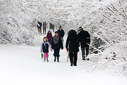 © Licensed to London News Pictures. 05/02/2012. Sanderstead, Surrey. People walking in the snow at Purley Beeches, Surrey. Ian Schofield/LNP