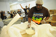 Nicor Inc. manager Cedric Collier fills bins of rice to be rationed and shipped to Jamaica at Feed My Starving Children in Schaumburg, Illinois on Saturday, May 21st, 2011 during Nicor's 15th Volunteer Day. The company's annual event includes volunteering at events like outdoor clean ups at local social service agencies, food sorting at area pantries and energy-saving improvements at the homes of senior citizens. For additional information, visit nicor.com or contact Richard Caragol at 630-388-2686.