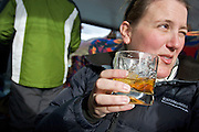 A hiker reacting after tasting the traditional post-hike whisky at the end of a Perito Moreno Glacier hike. The glacier is a popular hiking destination in Los Glaciares National Park, Argentina.