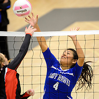 111413  Adron Gardner/Independent<br /> <br /> Laguna Acoma Hawk Ryanne Kie (4), right, tips a spike from a Eunice Cardinal during the state volleyball tournament at Cleveland High School in Rio Rancho Thursday.