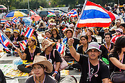 26 NOVEMBER 2013 - BANGKOK, THAILAND: Thai anti-government protestors gather in the courtyard of the Ministry of Finance in Bangkok. Protestors opposed to the government of Thai Prime Minister Yingluck Shinawatra spread out through Bangkok this week. Protestors have taken over the Ministry of Finance, Ministry of Sports and Tourism, Ministry of the Interior and other smaller ministries. The protestors are demanding the Prime Minister resign, the Prime Minister said she will not step down. This is the worst political turmoil in Thailand since 2010 when 90 civilians were killed in an army crackdown against Red Shirt protestors. The Pheu Thai party, supported by the Red Shirts, won the 2011 election and now govern. The protestors demanding the Prime Minister step down are related to the Yellow Shirt protestors that closed airports in Thailand in 2008.     PHOTO BY JACK KURTZ