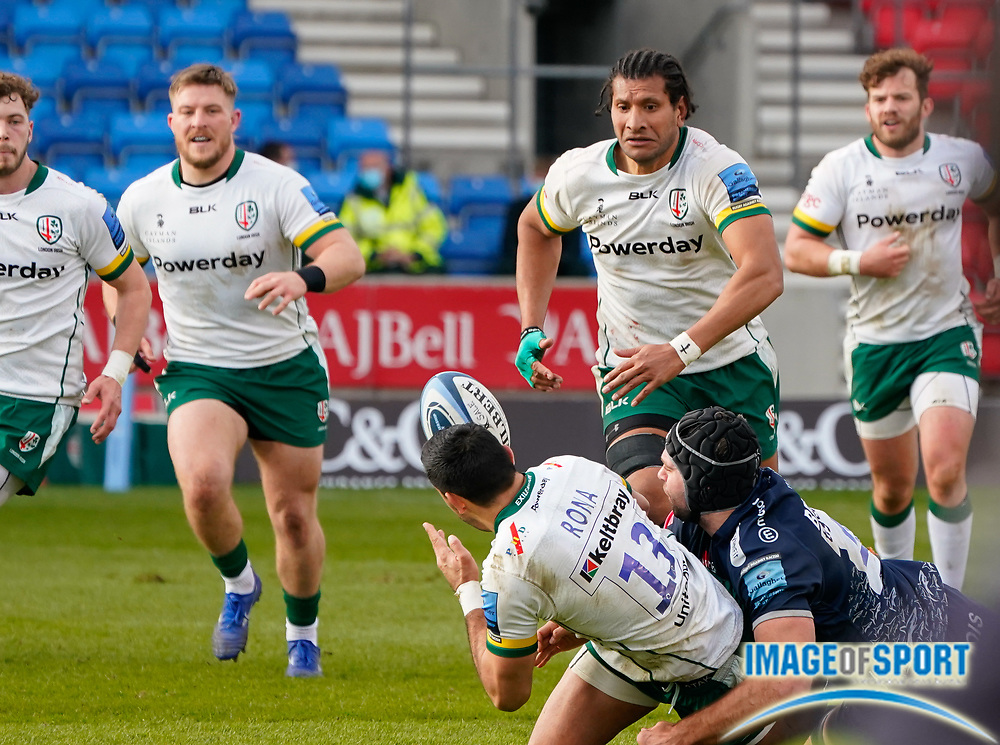 London Irish Centre Curtis Rona off-loads the ball to Lock Steve Mafi during a Gallagher Premiership Round 14 Rugby Union match, Sunday, Mar 21, 2021, in Eccles, United Kingdom. (Steve Flynn/Image of Sport)