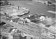 """ackroyd_02349-4. """"Dock Commission. aerials of Terminal 1 area. July 25, 1950"""" (Portland Terminal Railroad) Terminal 1 pier A & B and Lumber dock. Sills Storage & Transfer building is still standing at NW Upshur & 18th. Fitzgibbon Glass Co. building is still standing at 2001 NW 19th Ave. at the corner of Vaughn."""
