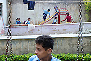 Disabled children are playing on a slide and on a swing during an afternoon at Chingari Trust Rehabilitation Centre in Bhopal, Madhya Pradesh, central India, near the abandoned Union Carbide (now DOW Chemical) industrial complex, site of the infamous 1984 gas tragedy in Bhopal, Madhya Pradesh, central India. The poisonous cloud that enveloped Bhopal left everlasting consequences that today continue to consume people's lives. The trust, funded by The Bhopal Medical Appeal, a British-based NGO, offers counselling, education, physiotherapy and love to hundreds of children born from gas-affected parents or fed highly contaminated water since an early age, when the body is more likely to be affected, and to suffer irreparable damage to health and wellbeing.