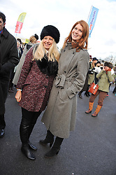 Left to right, ASTRID HARBORD and LARA HUGHES-YOUNG at the 2012 Hennessy Gold Cup at Newbury Racecourse, Berkshire on 1st December 2012