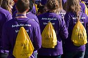 Young Catholic church groups from the Archdiocese of Liverpool await the start of the Hyde Park rally during Pope Benedict XVI's papal tour of Britain 2010, the first visit by a pontiff since 1982. Taxpayers footed the £10m bill for non-religious elements, which largely angered a nation still reeling from the financial crisis. Pope Benedict XVI is the head of the biggest Christian denomination in the world, some one billion Roman Catholics, or one in six people. In Britain there are about five million Catholics but only a quarter of Catholics regularly attend Sunday Mass and some churches have closed owing to spending cuts.